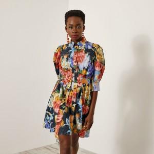 Φόρεμα εμπριμέ με ασύμμετρο τελείωμα
